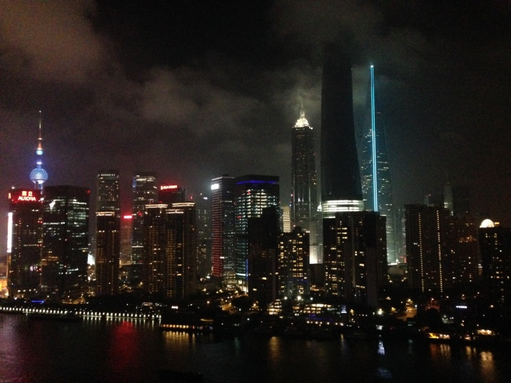 A view of the Lujiazui financial trade zone. The tall shadowy skyscraper, the Shanghai Tower, is still under construction and is set to open in 2015. It will have 121 floors at 2,073 feet tall.